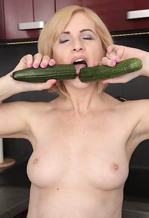 Jennyfer B shows how she likes it using a couple of huge cucumbers