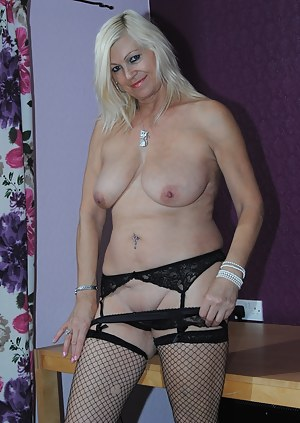 Platinum Blonde strips out of her secretary clothes flashes her pussy and tits