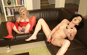 Two mature sluts masturbating at the same time on the couch
