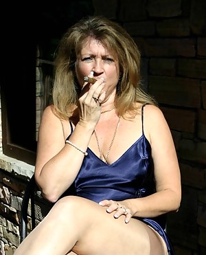Devlynn enjoys a relaxing view of mountains while slowly smoking a good cigarand oh, yeah, she has some interesting plac