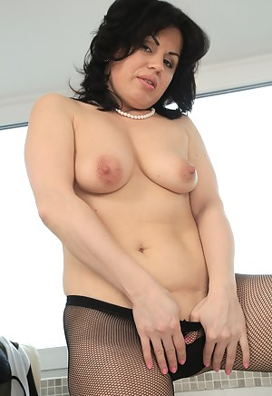 Curvy Nataly takes off her sheer stockings