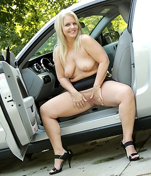 Mature and blonde BBW poses her naked ass by my sportscar