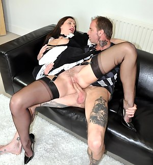 Hot slut Lara Latex having sex with a stud on the couch