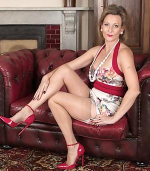 Older Huntingdon Smyth naked in red high heels.