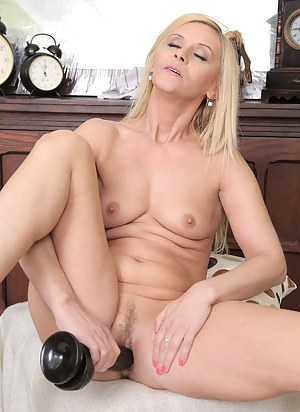 Horny blonde 44 year old Starlet enjoying two big black rubber dongs