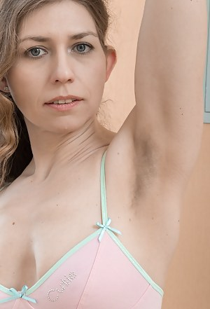 Elza is relaxing by her bend in her green dress on this day. She strips it off and shows her hairy pits, and her very hairy pussy. She sits on the bench, with legs spread open to show off her hot body.