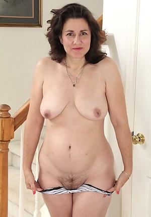 Curvy wife Gianna Jones spreads her hairy pussy.