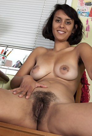 Sexy newcomer Sonya N strips down to her sexy brown body and uses her fingers to gently spread her hairy pussy lips on the chair.