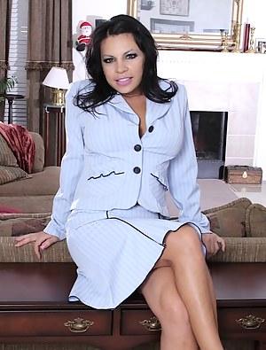 Busty Latin office babe Eva Salizar strips on her desk.