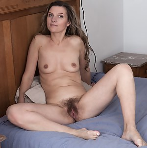 In her white lingerie and stockings, Aga is in her bedroom alone. She strips naked and lays naked in bed. She lays back naked, and touches her hairy pussy all over, and then poses bent over and more.