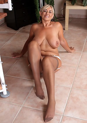 46 year old Melyssa from AllOver30 posing on the stairs in lingerie