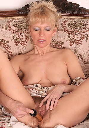 Hairy pussied MILF gets it on with her plastic friend