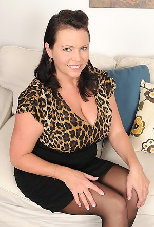 39 year old Angelica Sin gropes her massive titties on her couch