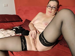 Naughty housewife fingering her hairy pussy