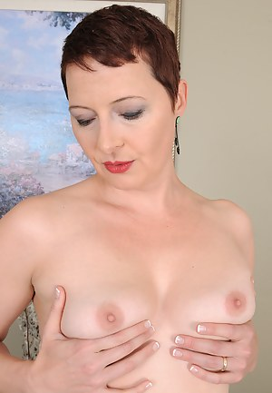 Short haired hottie Kali Karinena slips out of her bra and panties to play
