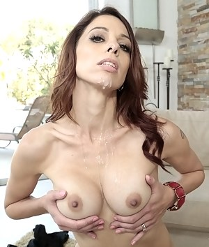 This slut's holes are extremely wide and sweet. Her lover is pushing his cock into her vagina and enjoying sensational blowjob.