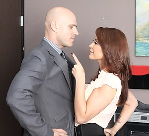 She doesn't mind getting overly touchy-feely with her coworkers, she doesn't mind it at all. Watch this stacked redhead get banged in the office!