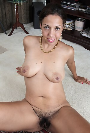 Exotic and elegant 37 year old Josephine Noelle spreading wide here