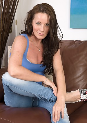 Cute and petite 44 year old Marlyn slides out of her denim jeans
