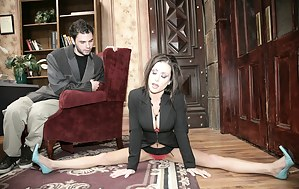 Lusty brunette in blue high heels practices splits in front of a guy, he obviously gets aroused and plows her leaking pussy on a desk.