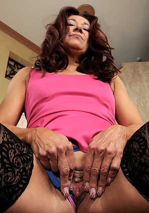 Petite 52 year old Renee Black from AllOver30 tugs her pussy lips