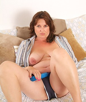 BBW Marishka enjoys her long blue toy in this gallery