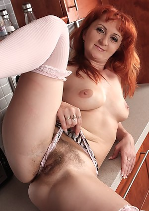 Redheaded MILF Trixi slips off her denim shorts to reveal hairy pussy
