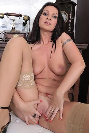 Beautiful brunette MILF Danni Stash spreads her stocking clad legs