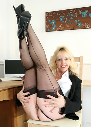Hot and horny secretary fucks her pink twat with a vibrator