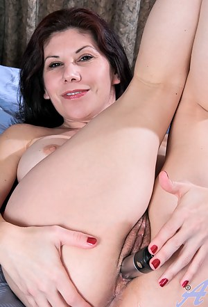 Anilols Kinsey massages her huge tits and stuffs a toy in her hairy pussy