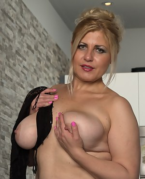 Big breasted housewife getting ready to play alone