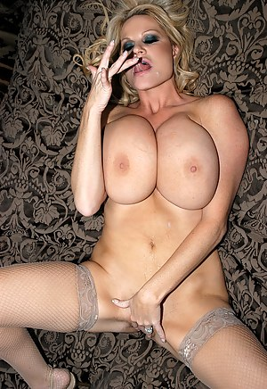 Kelly services her king on her knees and gets squirt with a hot creamy load on her tits.