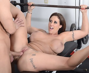 Come into the gym and see the powerful coach banging this busty model wildly. He is penetrating her sweet twat and touching her giant tits.