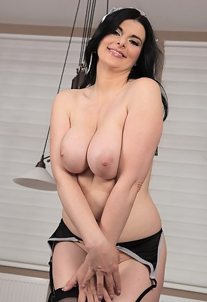 Gorgeous busty maid Sandra Nero does some work