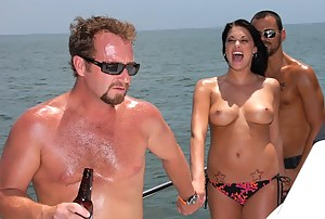 Welcome to the expensive boat where unforgettable threesome is taking place. The brunette MILF is getting fucked by two strong guys.