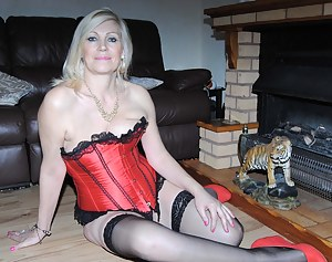 My sexy sister in her red and black basque,small panties, stockings and red shoes. Then strips of to reveal her DD's. Le