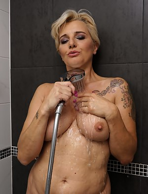 Naughty housewife getting extra wet under the shower