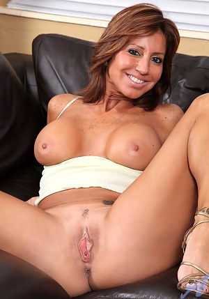 Brunette cougar proudly displays her big tits as she plays with her trusty vibrator