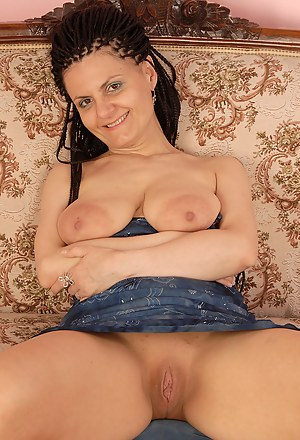 Mature brunette with big boobs shows off her shaven pussy